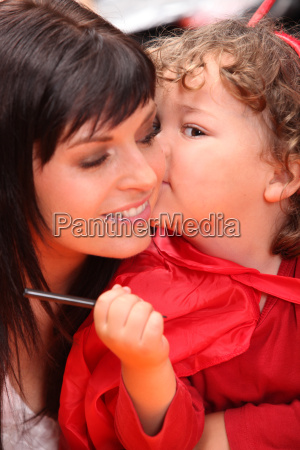 child whispering into her mother039s ear