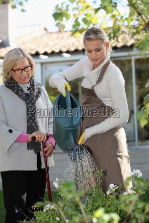 daughter watering plants