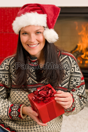 christmas present woman santa hat home