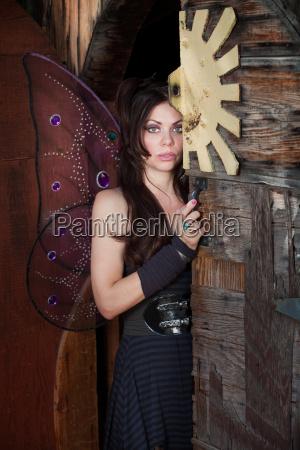fairy stands by door