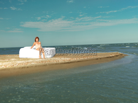 happy young woman white bed sea