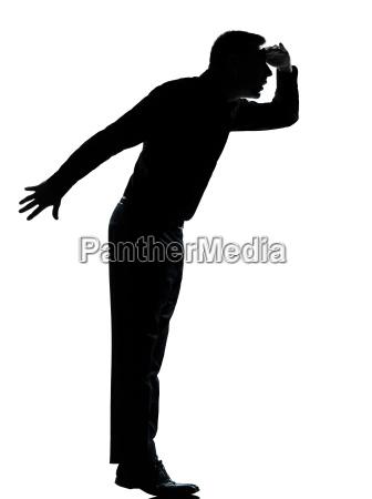 ein business mann silhouette auf zehenspitzen