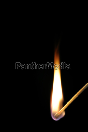 match flame on black background