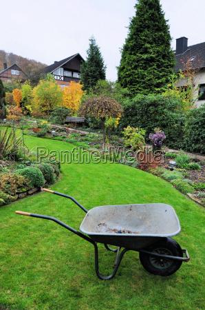 garden with wheelbarrow in autumn