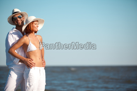 happy young couple standing on the