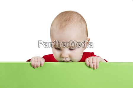 young child holding green shield