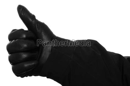 hand mit handschuh haelt daumen hoch