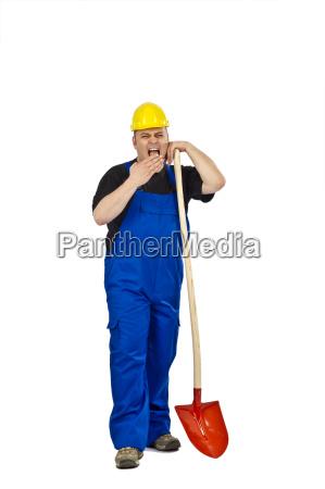 handwerker mit einer schippe