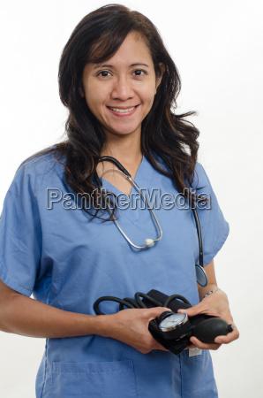 attraktiver asiatischer philippinischer krankenschwester arzt gesundheitswesen