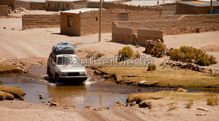 land rover in river bolivia altiplano