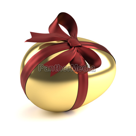 gold easter egg with red ribbon
