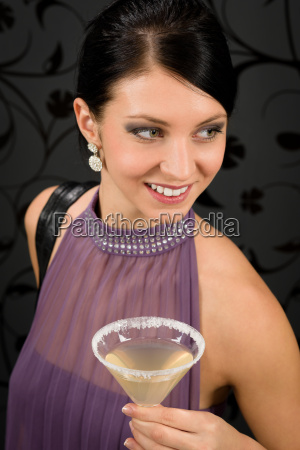 woman party dress hold cocktail glass