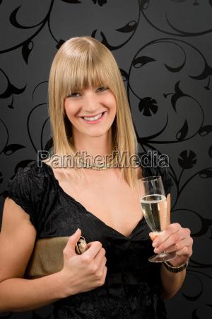 glamorous blond woman party dress drink