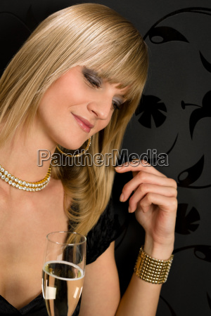 glamorous blond woman party dress closed
