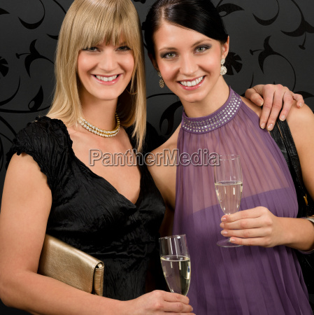 woman friends party dress hold champagne
