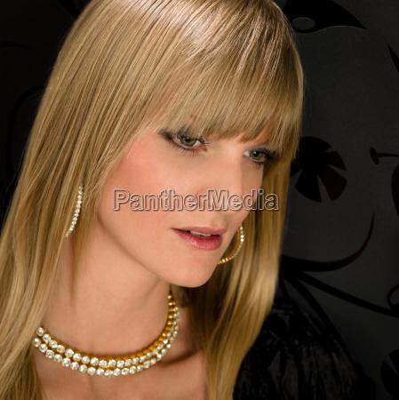 glamorous blond woman party dress jewelry
