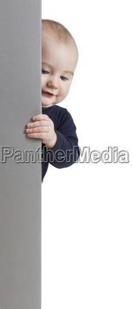 young child holding vertical sign