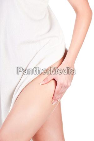 woman pinching leg for skin fold