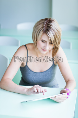 college studentbusinesswoman working on her tablet