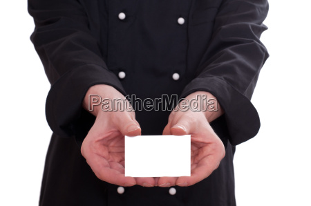 chef showing a business card with