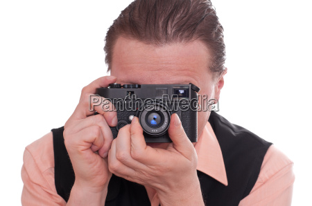photographer focuses a camera