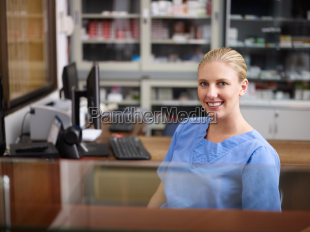 woman working as nurse at reception