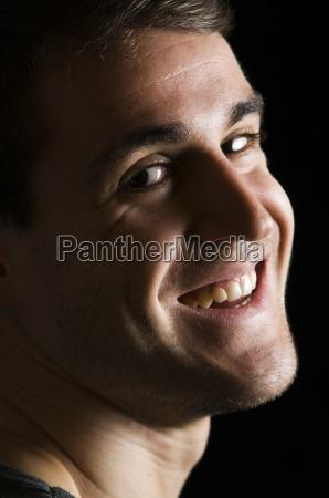 smiling man on black