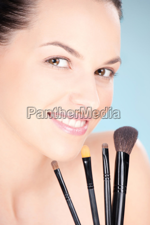 woman holding set of make up