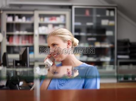 woman working as nurse in clinic