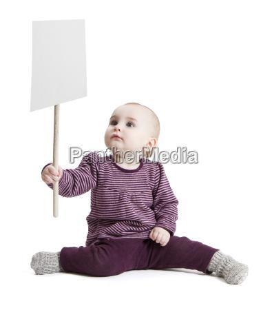 toddler holding sign