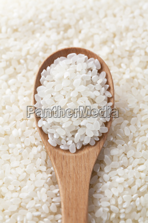 rice and wooden spoon