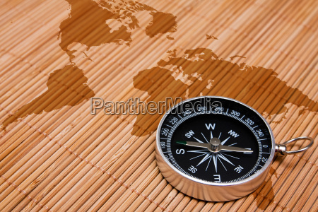 black compass on the abstract world