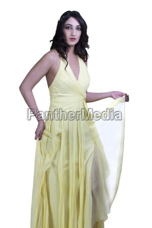 east indian teen woman standing yellow