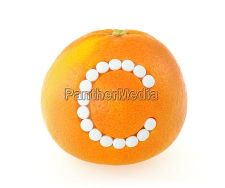 grapefruit with vitamin c pills over