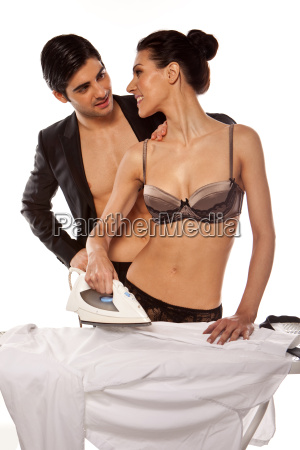 sexy couple doing ironing