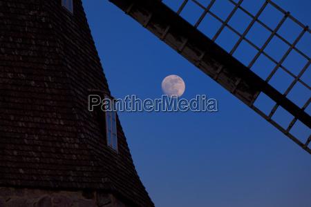 full moon behind a windmill
