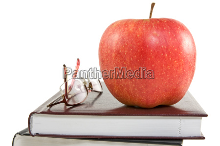 red apple and glasses on the