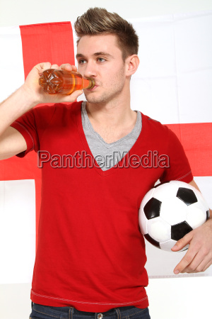 football fan celebrating with beer