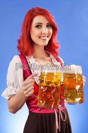 beautiful woman serving beer at oktoberfest