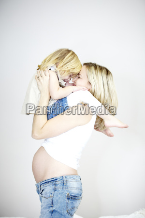 young pregnant mother with her daughter