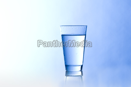 water glass with a blue background