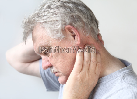 senior man with sore neck