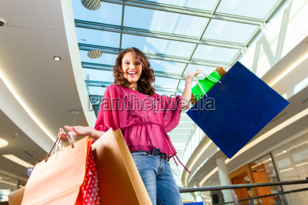 young woman shopping in a mall