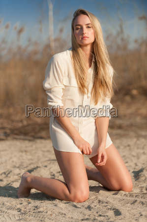 woman in blouse on the beach