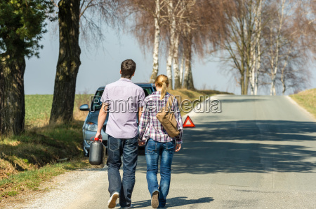 fill up petrol couple with car