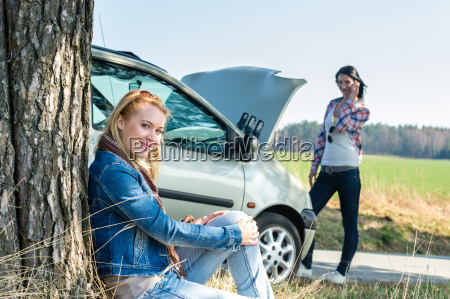 car defect two women waiting for