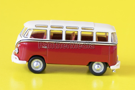 red bus isolated on yellow background