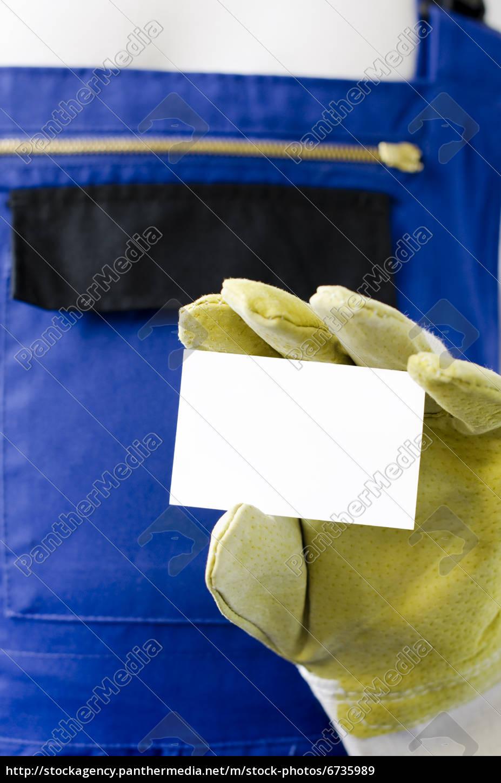 Lizenzfreies Bild 6735989 Handwerker Zeigt Eine Leere Visitenkarte Zum Beschriften