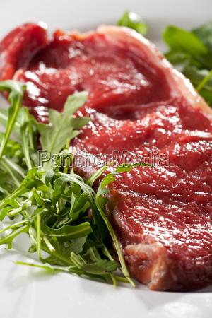 rohesn sirloin steak on rocket