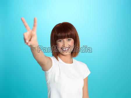 pretty woman showing victory sign